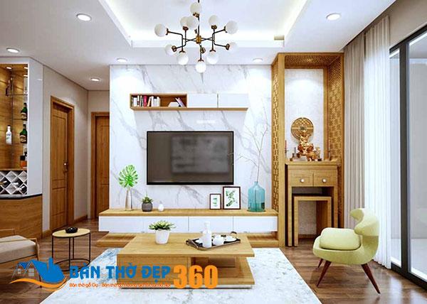 Mẫu bàn thờ nhà chung cư treo tường màu vàng nhẹ cùng tông màu với kệ tivi phòng khách
